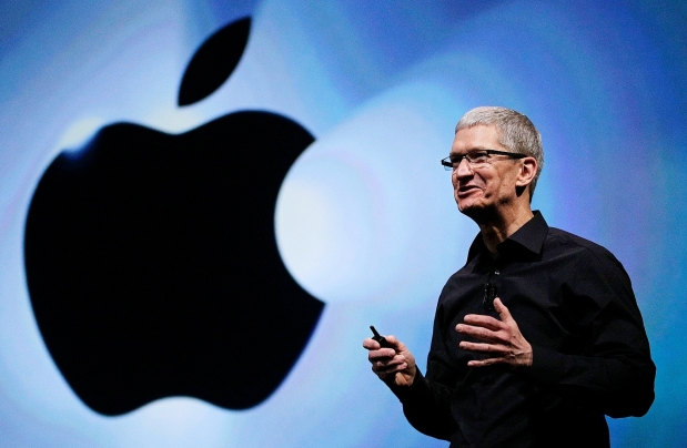 In this Wednesday, Sept. 12, 2012, file photo, Apple CEO Tim Cook soeaks during an introduction of the new iPhone 5 in San Francisco. Cook got a relatively modest $4.2 million in pay for 2012, after the company's board set him up with stock now worth $510 million for taking the reins in 2011. (AP Photo/Eric Risberg)