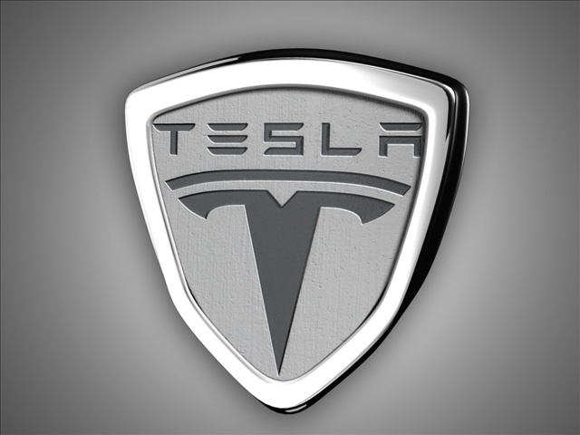 Photo of Tesla Motors Closes at Record After Apple Merger Rumor Surfaces
